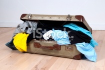stock-photo-13934748-suitcase-stuffed-with-clothes